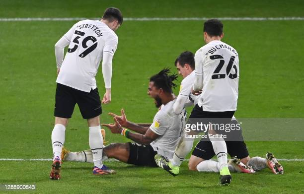 Colin Kazim-Richards of Derby County celebrates with teammates Jack Stretton, Jason Knight and Lee Buchanan after scoring his team's first goal...
