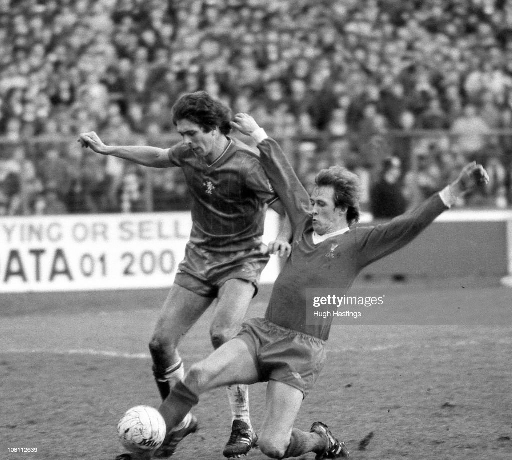 Colin Lee of Chelsea is tackled by Phil Neal of Liverpool during the FA Cup 5th Round match between Chelsea and Liverpool held on February 13, 1982 at Stamford Bridge, in London, England. Chelsea won the match and tie 2-0.