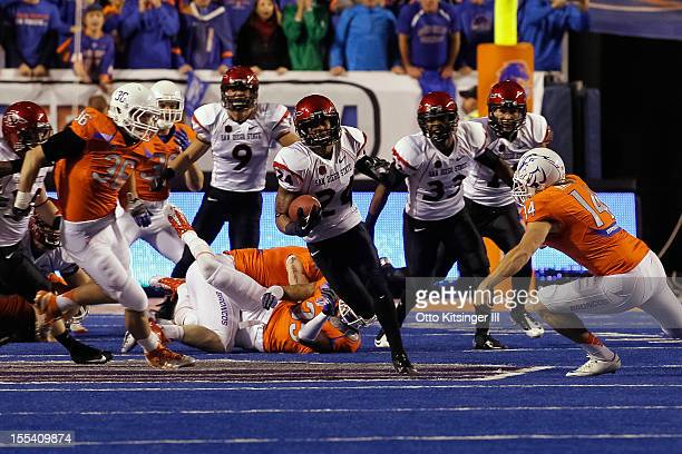 Colin Lockett of the San Diego State Aztecs returns the opening kickoff for a touchdown against the Boise State Broncos at Bronco Stadium on November...