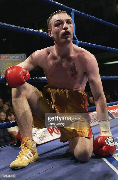 Colin Lynes of England takes an eight count during the IBO Intercontinental Light-Welterweight Championship fight between Colin Lynes of England and...