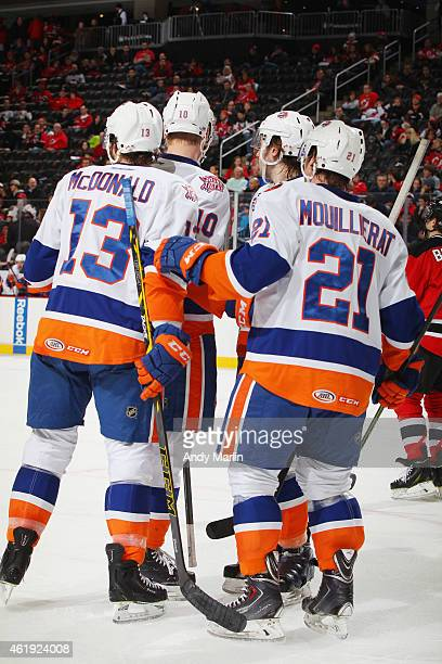 Colin McDonald of the Bridgeport Sound Tigers is congratulated after scoring a second period goal against the Albany Devils during the game at the...
