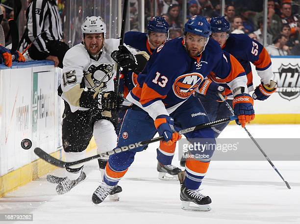 Colin McDonald of the New York Islanders skates against Tanner Glass of the Pittsburgh Penguins in Game Four of the Eastern Conference Quarterfinals...