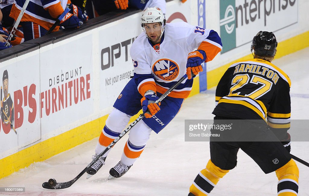 Colin McDonald #13 of the New York Islanders skates with the puck against the Boston Bruins at the TD Garden on January 25, 2013 in Boston, Massachusetts.