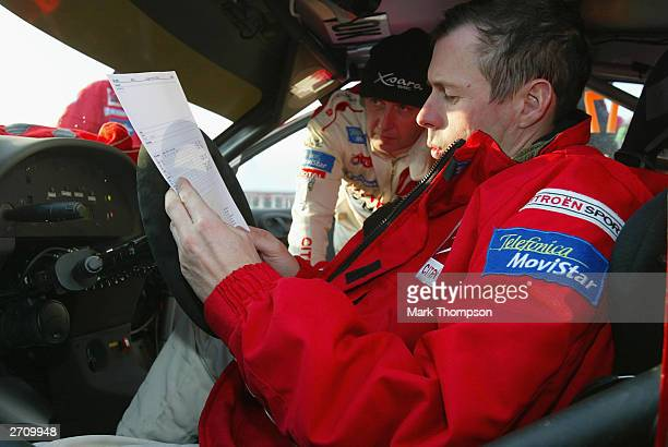 Colin McRae of Great Britain and Citroen examines his stage times at Felindre service area during the Wales Rally GB in Rheola on November 8 2003 in...