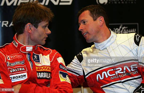 Colin McRae of Team GB chats to Marcus Gronholm of Team Finland during the Race of Champions at the Stade de France on December 3 2004 in Paris France