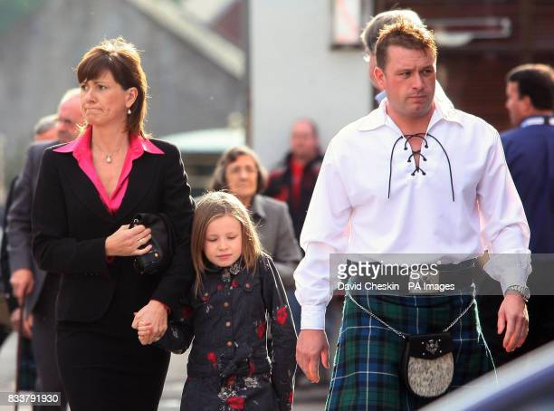 Colin McRae's brother Stuart McRae is pictured with Alison McRae and her daughter Holliew, as they arrive for the Service of Celebration for her...