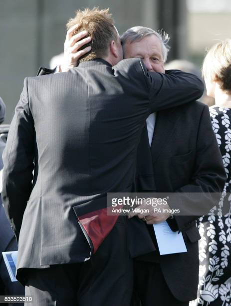 Colin McRae's father, Jimmy, gets a hug after he leaves the funeral of Colin McRae and son Johnny at East Chapel, Daldowie Crematorium.