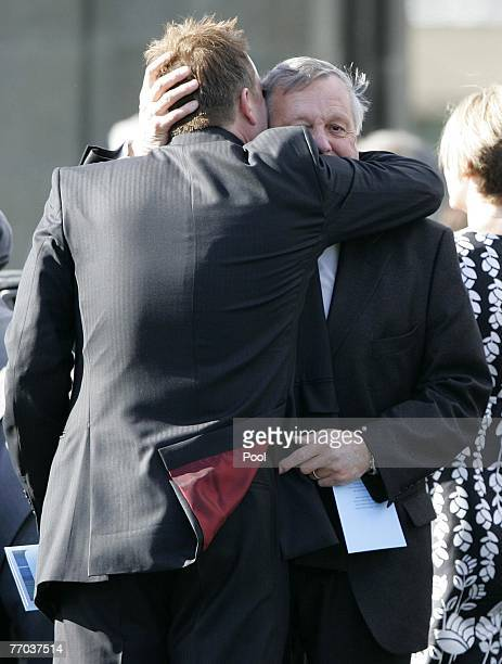 Colin McRae's father, Jimmy McRae, is hugged after he leaves the funeral of Colin McRae and son Johnny at East Chapel, Daldowie Crematorium on...
