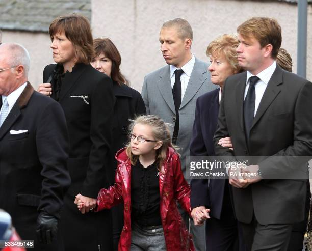 Colin McRae's widow Alison McRae , her daughter Hollie , and Colin McRae's brother Jimmy arrive for the funeral of Ben Porcelli, who died in a...