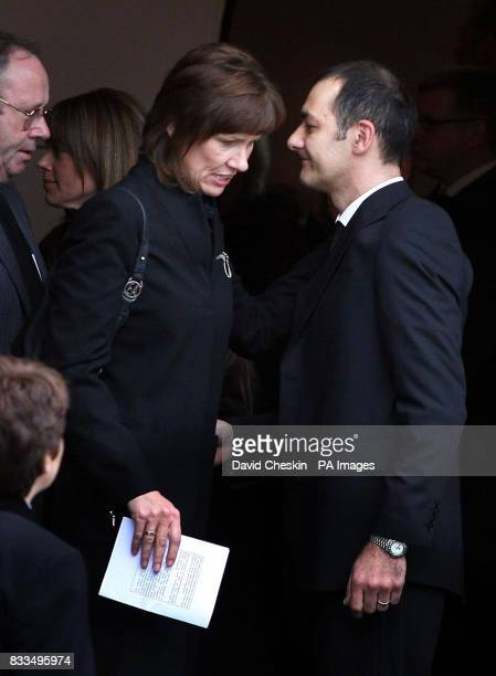 Colin McRae's widow Alison McRae , passes Ben Porcelli's father Mark Porcelli following the funeral of Ben Porcelli, who died in a helicopter crash...