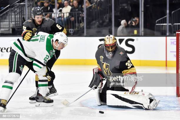 Colin Miller and goalie Malcolm Subban of the Vegas Golden Knights defend against Antoine Roussel of the Dallas Stars during the game at TMobile...