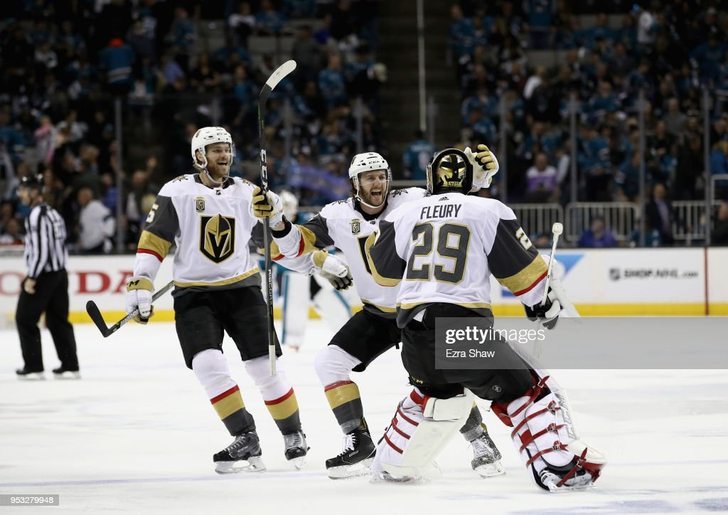 Colin Miller #6 and Jon Merrill #15 congratulate Marc-Andre Fleury #29 of the Vegas Golden Knights after they beat the San Jose Sharks in Game Three of the Western Conference Second Round during the 2018 NHL Stanley Cup Playoffs at SAP Center on April 30, 2018 in San Jose, California.