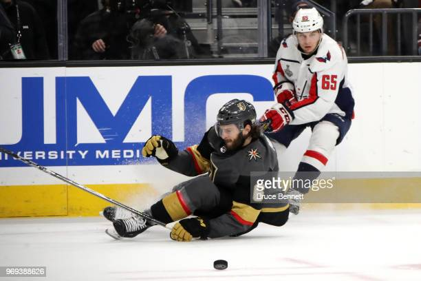Colin Miller of the Vegas Golden Knights and Andre Burakovsky of the Washington Capitals battle for the puck during the first period in Game Five of...