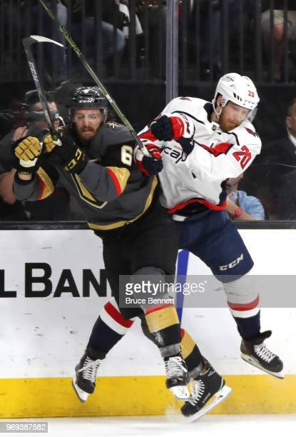 Colin Miller of the Vegas Golden Knights is checked by Lars Eller of the Washington Capitals during the first period in Game Five of the 2018 NHL...