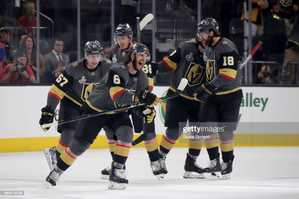 Colin Miller #6 of the Vegas Golden Knights is congratulated by his teammates after scoring a first-period goal against the Washington Capitals in Game One of the 2018 NHL Stanley Cup Final at T-Mobile Arena on May 28, 2018 in Las Vegas, Nevada.