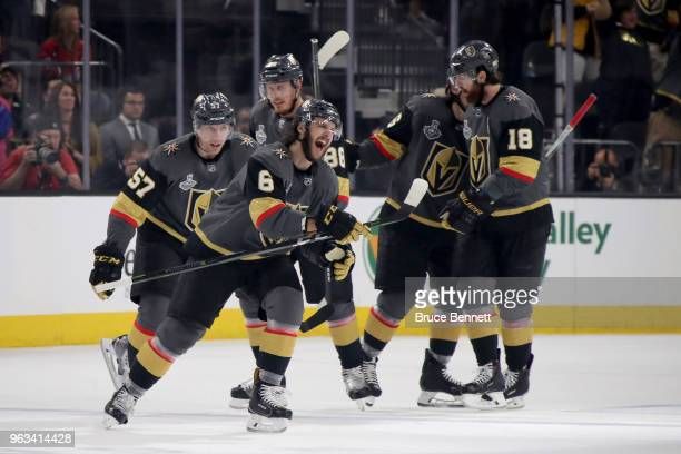 Shea Theodore of the Vegas Golden Knights pressures Evgeny Kuznetsov of the Washington Capitals during the third period of Game One of the 2018 NHL...