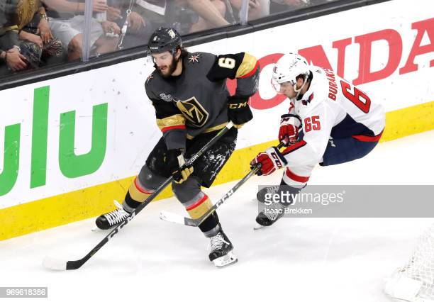 Colin Miller of the Vegas Golden Knights is pursued by Andre Burakovsky of the Washington Capitals during the first period in Game Five of the 2018...