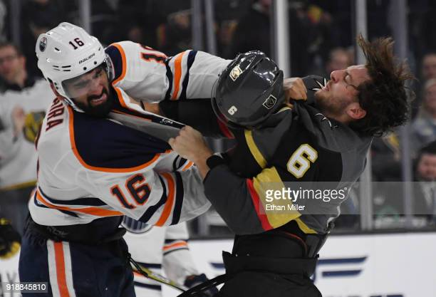 Colin Miller of the Vegas Golden Knights loses his helmet as he fights Jujhar Khaira of the Edmonton Oilers in the third period of their game at...