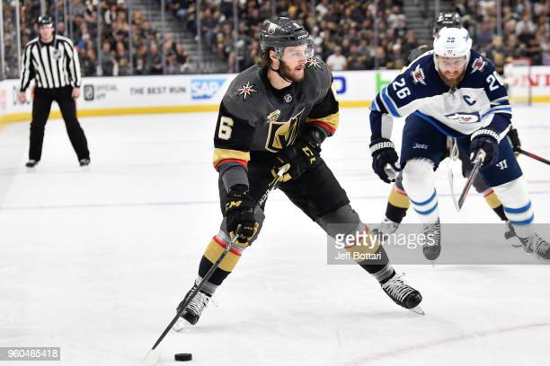 Colin Miller of the Vegas Golden Knights skates with the puck while Blake Wheeler of the Winnipeg Jets defends in Game Three of the Western...