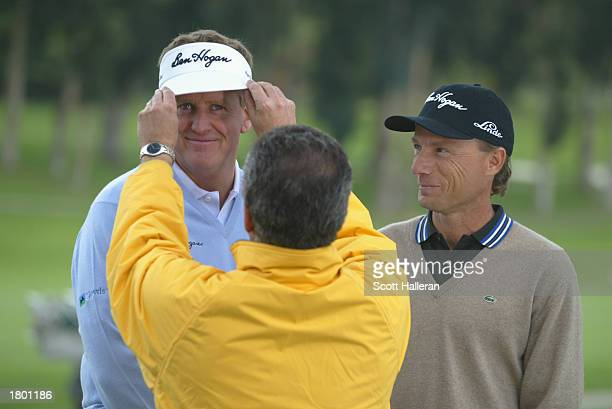 Colin Montgomerie and Bernhard Langer share a laugh during the taping of a Ben Hogan television spot during practice for the Nissan Open on February...