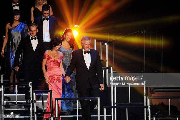 Colin Montgomerie and his wife Gaynor Montgomerie along with members of the European Ryder Cup team walk onstage during Welcome To Wales at...