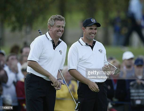 Colin Montgomerie and Padraig Harrington of Europe in happy mood on the 14th green during the afternoon fourball matches on the second day of the...