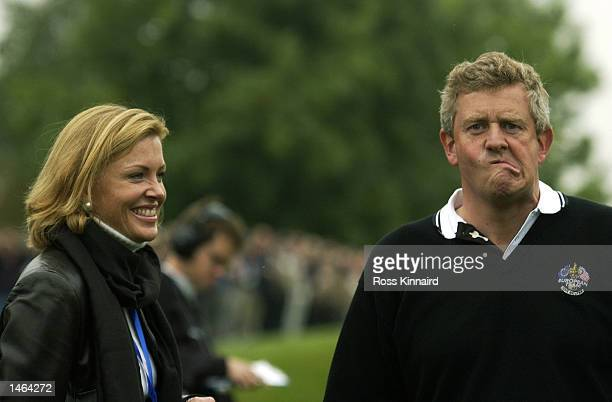 Colin Montgomerie of Europe with his wife Eimear on the 15th green during the morning foursomes on the second day of the 34th Ryder Cup matches...