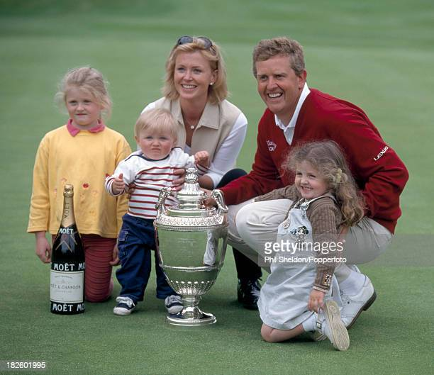 Colin Montgomerie of Great Britain his wife Eimear and their children Olivia Cameron and Venetia posing with the trophy after winning the PGA...