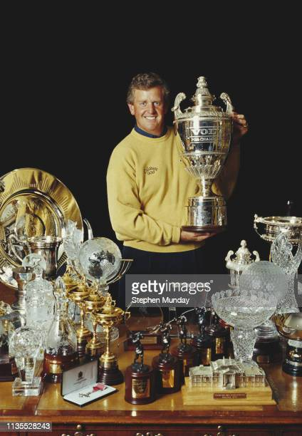 Colin Montgomerie of Great Britain poses with his golfing trophies and cups on 8 November 1999 United Kingdom