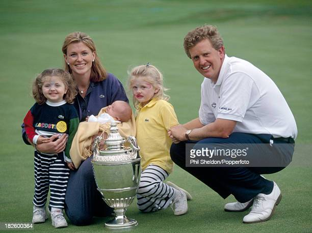 Colin Montgomerie of Great Britain poses with his wife Eimear their children Venetia Olivia and baby Cameron and the trophy after winning the PGA...