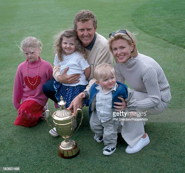 Colin Montgomerie of Great Britain poses with his wife Eimear their children Olivia Venetia and Cameron and the trophy after winning the Benson and...
