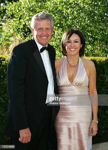 Colin Montgomerie of Scotland and partner Gaynor Knowles pose in evening dress at the Tour Dinner prior to the BMW Championship at The Wentworth Club...