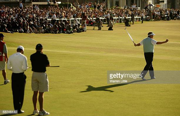 Colin Montgomerie of Scotland celebrates on the 18th green after holing a birdie putt during the third round of the 134th Open Championship at Old...