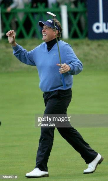 Colin Montgomerie of Scotland celebrates winning the Dunhill Links Championship after putting a birdie on the 18th green during the final round on...
