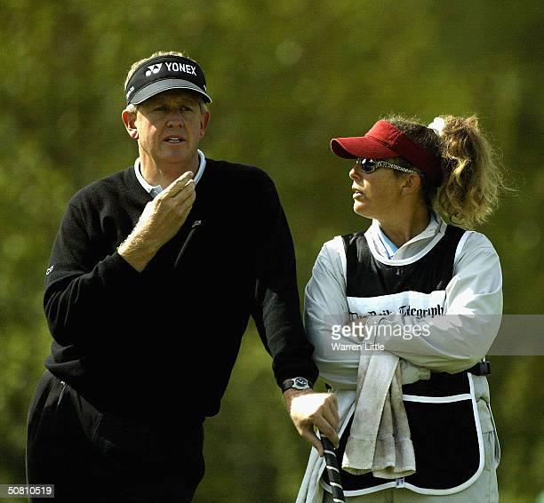 Colin Montgomerie of Scotland gestures as he speaks with Nick Faldo's caddie Fanny Sunesson Rogers during the second round of the Daily Telegraph...