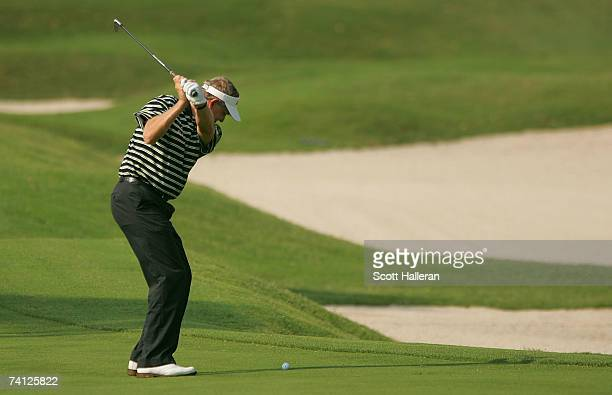 Colin Montgomerie of Scotland hits a shot on the second hole during the first round of THE PLAYERS on the Stadium Course at the TPC Sawgrass on May...
