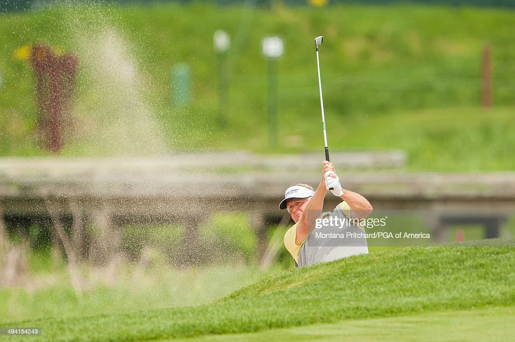 Colin Montgomerie of Scotland hits a shot out of a bunker on the 18th hole during the first round for the 75th Senior PGA Championship presented by KitchenAid held at Harbor Shores Golf Club on Thursday, May 22, 2014 in Benton Harbor, Michigan.