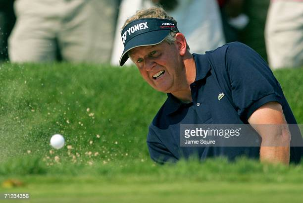 Colin Montgomerie of Scotland hits from the bunker on the fifth hole during the final round of the 2006 US Open Championship at Winged Foot Golf Club...