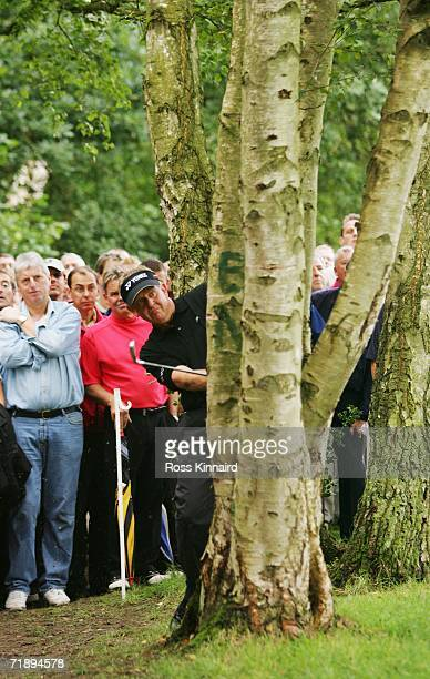 Colin Montgomerie of Scotland hits his second shot on the 17th hole during the Second Round of the HSBC World Matchplay Championship at The Wentworth...