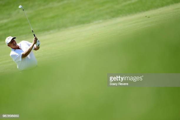 Colin Montgomerie of Scotland hits his third shot on the ninth hole during the third and final round of the American Family Championship at...