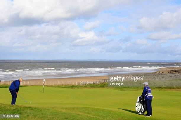 Colin Montgomerie of Scotland in action during the final round of the Senior Open Championship at Royal Porthcawl Golf Club on July 30, 2017 in...