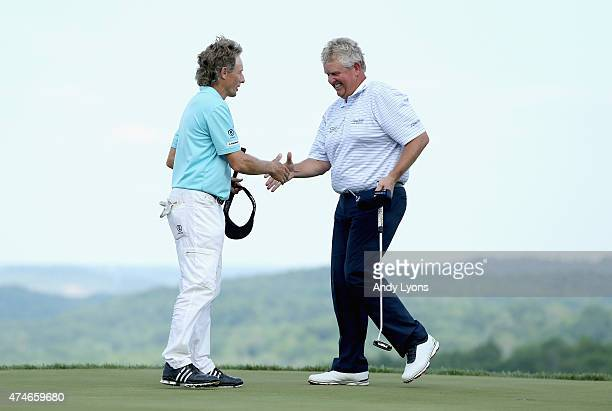 Colin Montgomerie of Scotland is congratulated by Bernhard Langer after winning the Senior PGA Championship Presented By KitchenAid at the Pete Dye...