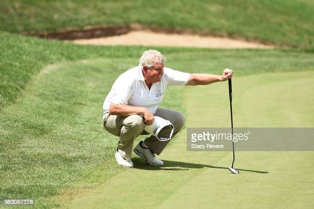 Colin Montgomerie of Scotland lines up a putt on the 18th green during the third and final round of the American Family Championship at University...
