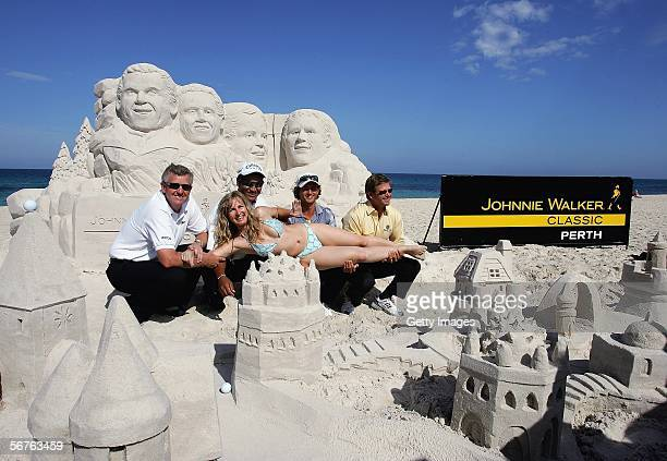 Colin Montgomerie of Scotland Michael Campbell of New Zealand Adam Scott of Australia and Retief Goosen of South Africa pose with sand sculptress...