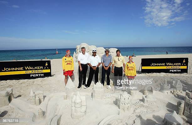 Colin Montgomerie of Scotland, Michael Campbell of New Zealand, Adam Scott of Australia, Retief Goosen of South Africa pose with two lifeguards who...