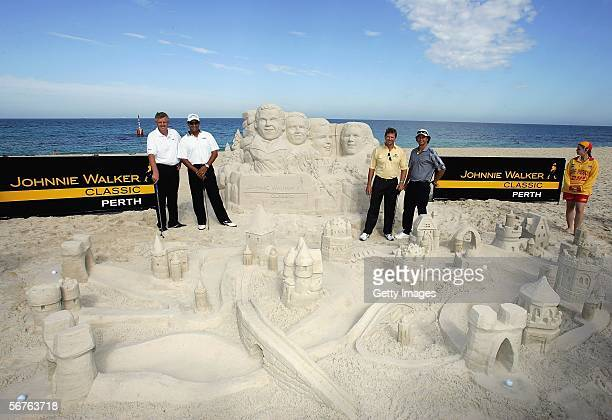 Colin Montgomerie of Scotland Michael Campbell of New Zealand Adam Scott of Australia Retief Goosen of South Africa pose with a lifeguard who helped...