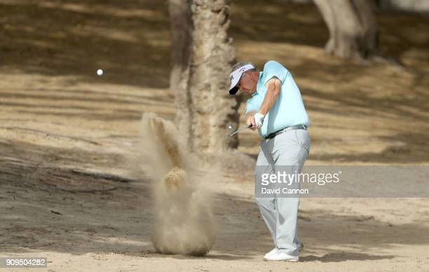 Colin Montgomerie of Scotland plays a shot during the proam as a preview for the Omega Dubai Desert Classic on the Majlis Cours at Emirates Golf Club...