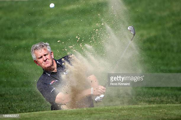 Colin Montgomerie of Scotland plays from a bunker during the proam event prior to the Abu Dhabi HSBC Golf Championship on January 16 2013 in Abu...