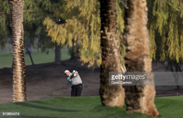 Colin Montgomerie of Scotland plays his second shot on the par 4 17th hole during the completion of the second round of the Omega Dubai Desert...
