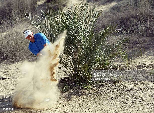 Colin Montgomerie of Scotland plays his second shot on the par four 8th hole during the third round of the 2004 Dubai Desert Classic on the Majlis...